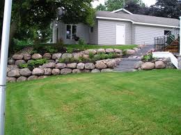another two tier boulder retention wall with middle planting area