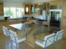 small wooden island with stainless steel countertop light wood