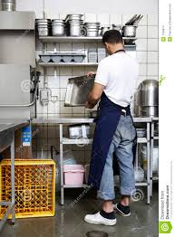 man cleaning the kitchen stock images image 7789874