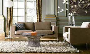 Beautiful And Inspiring Living Room by Brown Fabric Sofa With Black Pattern Cushion Added By Round Glass