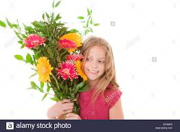 happy child with bouquet of flowers for mother u0027s day stock photo