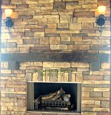 interior solid wood mantel and stone fireplace with wood mantel