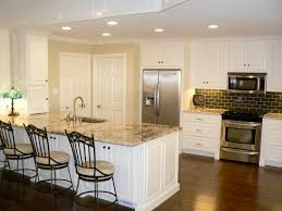 travertine countertops off white kitchen cabinets lighting