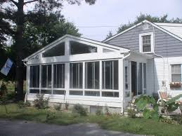 a frame screened in front porch minus the windows just