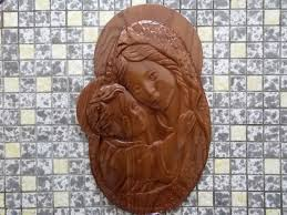holding baby jesus christian wall wood carving