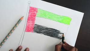 a kid drawing a uae national flag sketch with color pencils a top