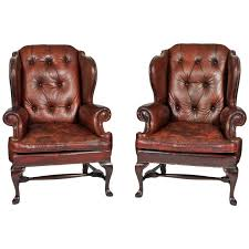 Winged Armchairs For Sale Pair Of Early 20th Century Brass Tacked Tufted Leather High Back