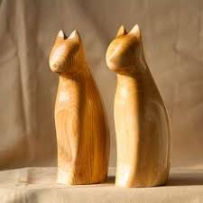 wooden cat caring for cats and how to take care of cats with and