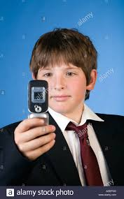 11 year school boy taking photo with mobile phone stock photo