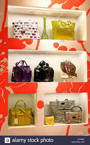 luxury designer handbags on display in a singapore shopping mall