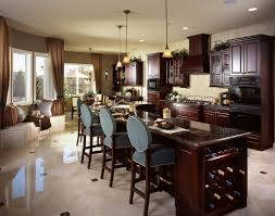 399 kitchen island ideas for 2017 dark cherry wood and darker marble countertops unify this kitchen featuring expansive l shaped