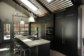 contemporary kitchen using black cabinets and hanging industrial