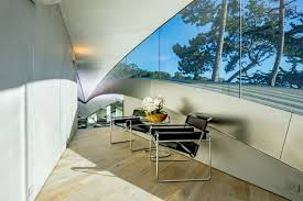 Classic Reading Chair by A Stunning Butterfly Inspired House On The California Coast