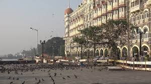 pigeons fly in front of the taj mahal hotel in mumbai stock video