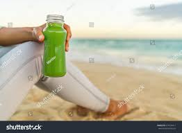 green drink healthy green juice detox smoothie drink stock photo 674134411