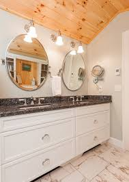 round mirror over with beach vacation home bathroom beach style