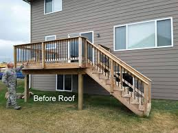 Pictures Of Roofs Over Decks by Metal Roof Over Deck Des Moines Deck Builder Deck And Drive