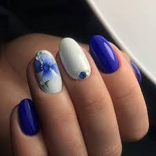 elegant looking blue and white studded nails this elegant looking