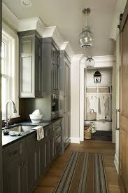 gray kitchen cabinets with white crown molding charcoal gray pantry cabinets with brass hardware cottage