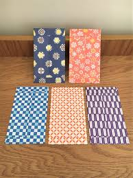 origami paper gift envelopes with bright modern designs voucher