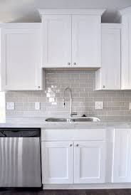 white kitchen backsplash smoke glass subway tile white shaker cabinets shaker cabinets