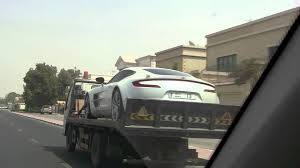 aston martin truck aston martin one 77 on crappy truck in dubai youtube