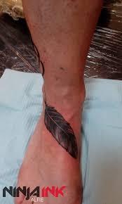 the 25 best feather tattoo wrist ideas on pinterest feather