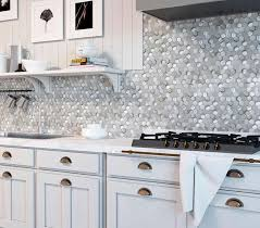white kitchen cabinets with hexagon backsplash white ceramic and pearl glass hexagon mosaic tile