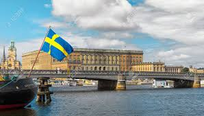 swedish flag with the royal castle in background stockholm stock