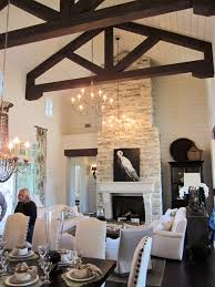 Southern Hearth And Patio A Two Story Limestone Fireplace And Dark Brown Trusses Set The