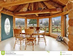 beautiful dining room in log cabin house royalty free stock photos