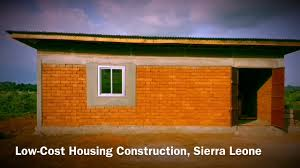 low cost housing construction with interlocking bricks made in