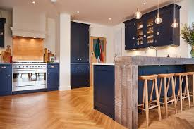 blue kitchen cabinets with copper hardware a contemporary redesign with rich blue painted cabinets