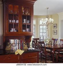 stock photo of kitchens built in cherry hutch leads into the