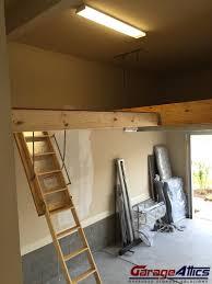 garage storage loft solutions custom overhead garage storage lofts garage loft with pull down stairs
