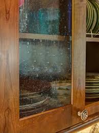 add glass to kitchen cabinet doors warm earthy kitchen glass doors banks and doors