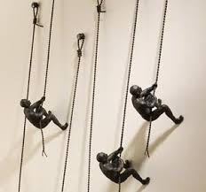 unique climbing man wall sculpture art piece home décor