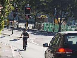 fine for running a red light cyclists without helmets seem unaware of new laws and huge fines in