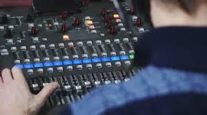 sound designer 4k sound designer puts headphones working on the sound contro