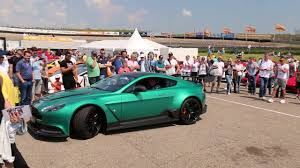 green aston martin british racing green aston martin vantage gt12 revving lovely