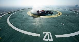 formula one race car does donuts on helipad atop the burj al arab