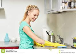 cleaning kitchen happy woman cleaning table at home kitchen stock image image of
