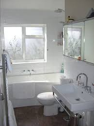 bathroom white bathtub beside small space saving bathroom sinks