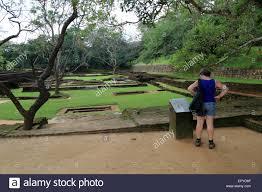 Water Rock Garden by Woman Tourist In The Water Gardens Of Sigiriya Rock Palace