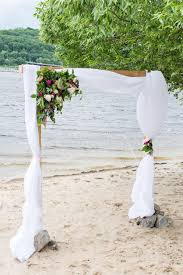 wedding arch greenery a wedding arch with greenery peonies and white material stock
