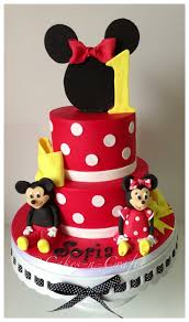 minnie mouse tiered cake with edible mickey and minnie
