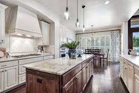 white kitchen cabinets with river white granite choosing a marble countertop kristen rinn design