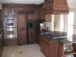 painted and stained kitchen cabinets staining kitchen cabinets before and after pure white granite