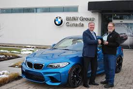 bmw ceo hans blesse left president and ceo of bmw group canada accepts