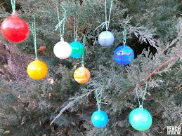 solar system ornaments teach beside me